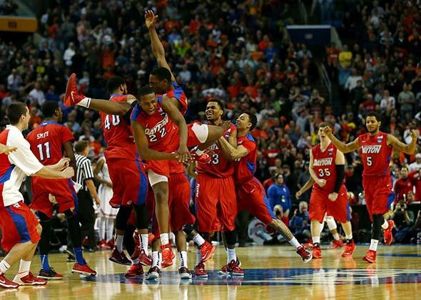 The Dayton Flyers celebrate after defeating the Ohio State Buckeyes.