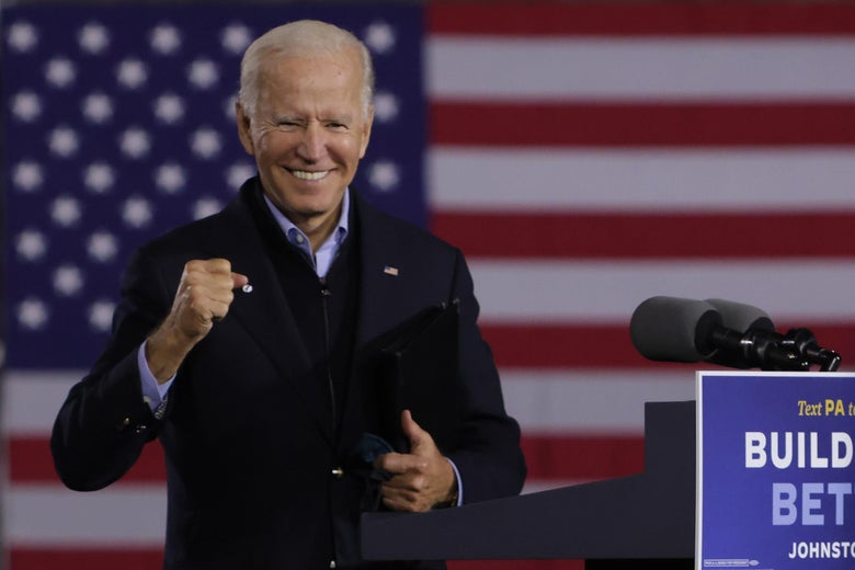 Joe Biden pumps his fist while standing in front of an American flag during a campaign stop in Pennsylvania.