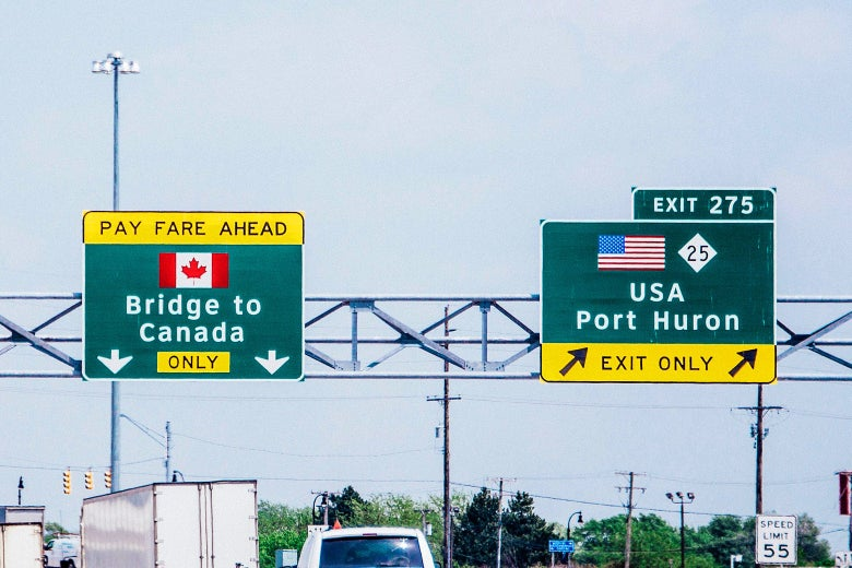 Highway signs show the way to the Bridge of Canada and Port Huron.