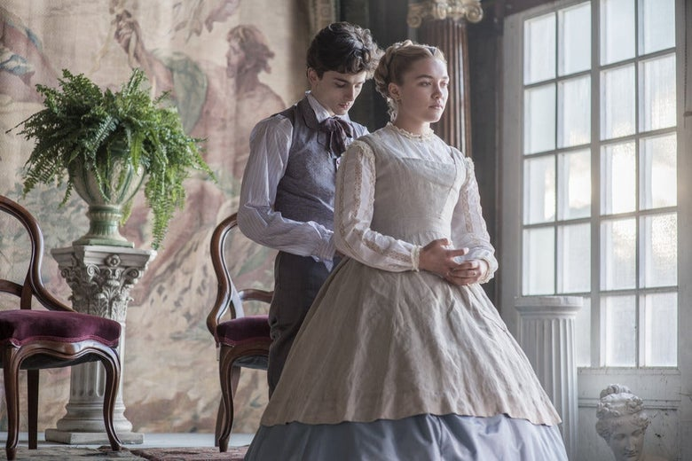 In a scene from Little Women, Chalamet stands behind Pugh, looking down as if buttoning the back of her dress.