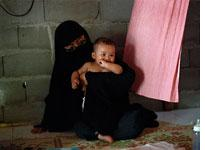 Paridah with her youngest child, Osama. Click image to expand.