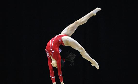 Ivana Hong Of The U S Performs Her Routine On The Beam During The Qualifying Round Of