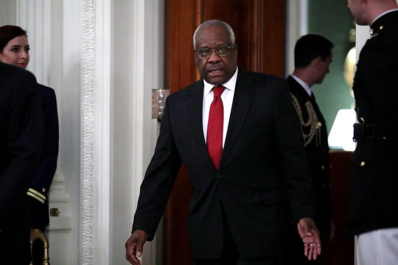 Justice Clarence Thomas walks into a room with a decisive stride.