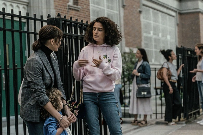 Jenny Slate and Rashida Jones stand outside a school
