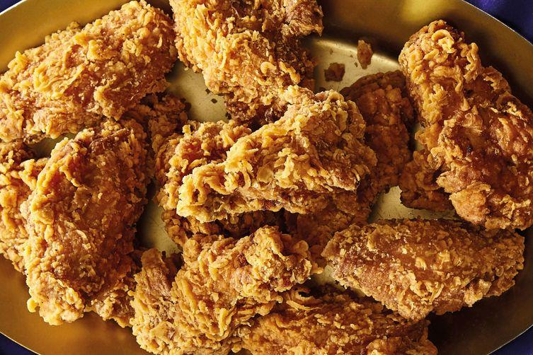 Crispy chicken wings sit in a bowl.