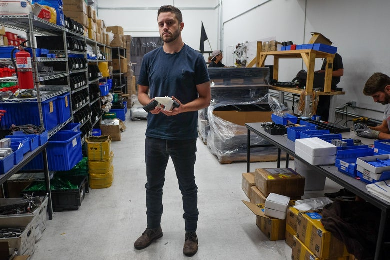 Cody Wilson, owner of Defense Distributed company, holds a 3D printed gun, called the 'Liberator', in his factory in Austin, Texas on August 1, 2018. - The US 'crypto-anarchist' who caused panic this week by publishing online blueprints for 3D-printed firearms said Wednesday that whatever the outcome of a legal battle, he has already succeeded in his political goal of spreading the designs far and wide. A federal court judge blocked Texan Cody Wilson's website on Tuesday, July 31, 2018, by issuing a temporary injunction. (Photo by Kelly WEST / AFP)        (Photo credit should read KELLY WEST/AFP/Getty Images)
