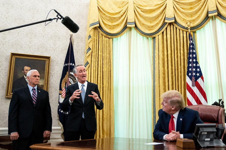 Pence and O'Day stand in the Oval Office while Trump sits behind his desk.