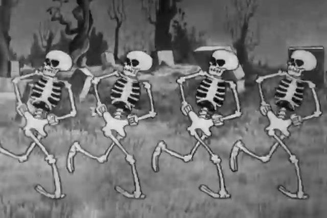 Four skeletons dancing in a row.