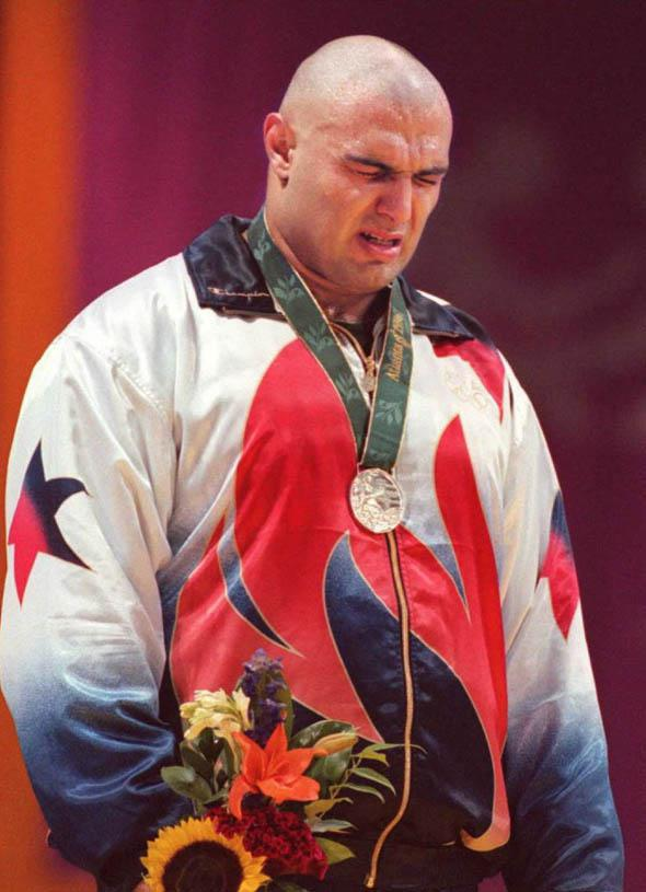 Matt Ghaffari of the US sobs on the podium after losing to Russian Alexander Karelin in the Olympic super heavyweight Greco-Roman wrestling final 23 July. Karelin took the gold.
