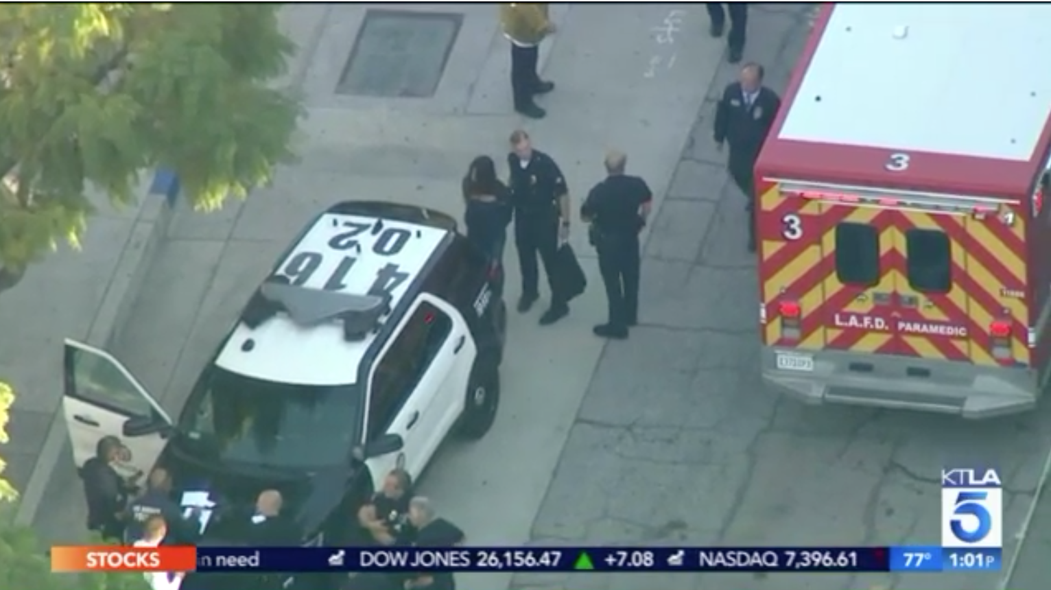A screen grab from helicopter news footage shows officers leading a handcuffed girl with long hair to a waiting squad car after a shooting at the Salvador Castro Middle School in Los Angeles on Feb. 1, 2018.
