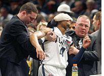 Allan Ray is helped off the court          Click image to expand.