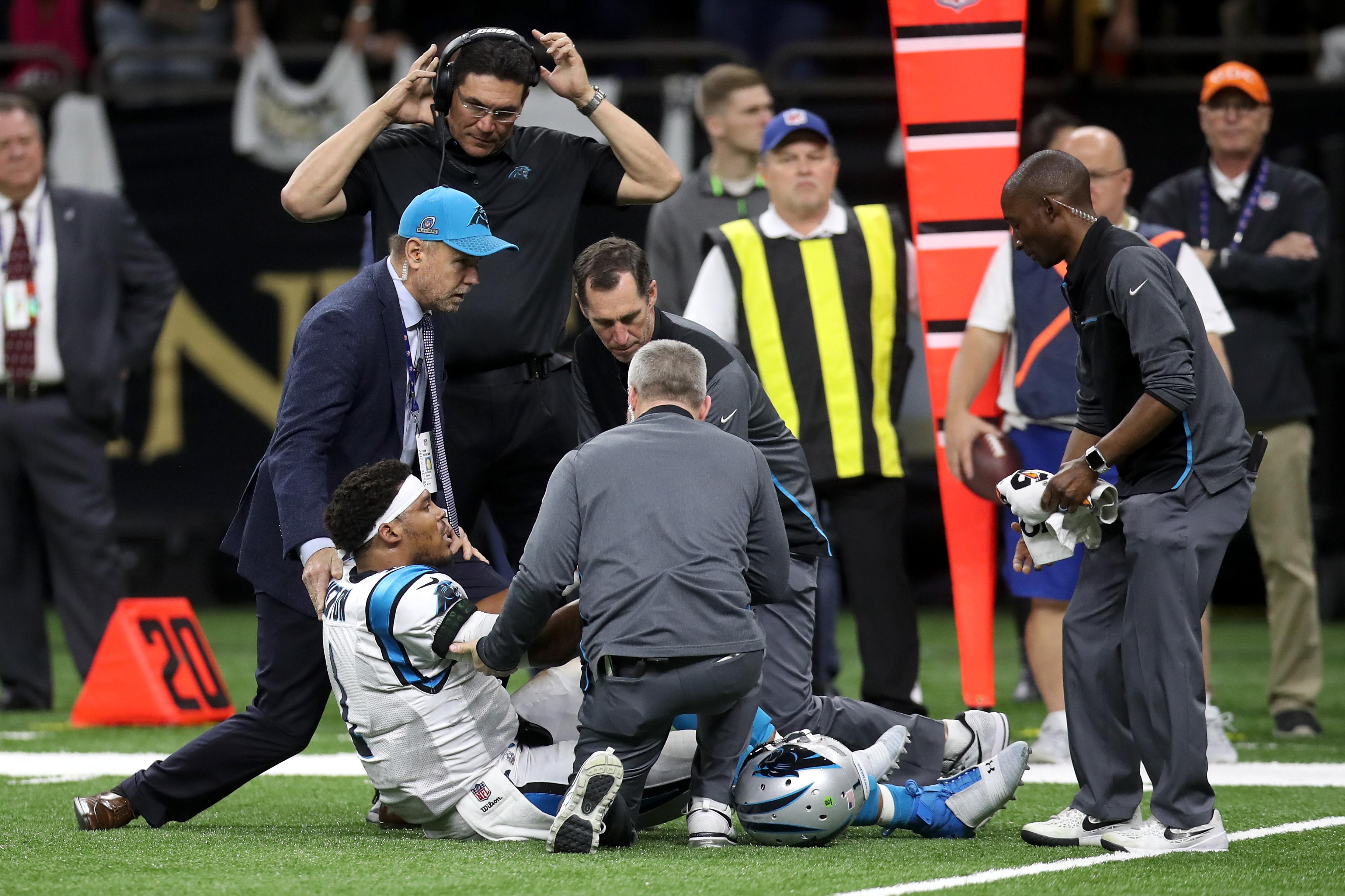 NEW ORLEANS, LA - JANUARY 07:  Cam Newton #1 of the Carolina Panthers is checked on the sideline after a tackle during the game against the New Orleans Saints at the Mercedes-Benz Superdome on January 7, 2018 in New Orleans, Louisiana.  (Photo by Chris Graythen/Getty Images)