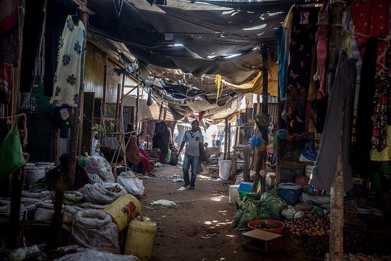 A man walks through a market in the Dadaab refugee camp.