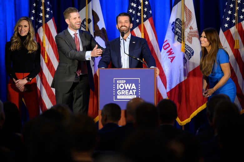 "Donald Trump Jr. (C) speaks with his brother Eric (2nd L) and wife Lara, as well as his girlfriend Kimberly Guilfoyle (R) during a ""Keep Iowa Great"" press conference in Des Moines, IA, on February 3, 2020."