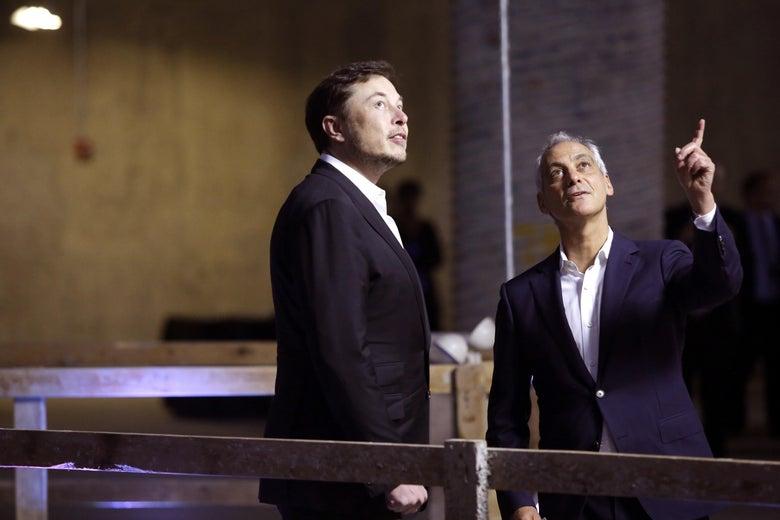 Elon Musk looking up at a bright light.