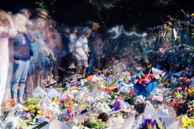 Mourners gathered in front of floral tributes to the New Zealand shooting victims.