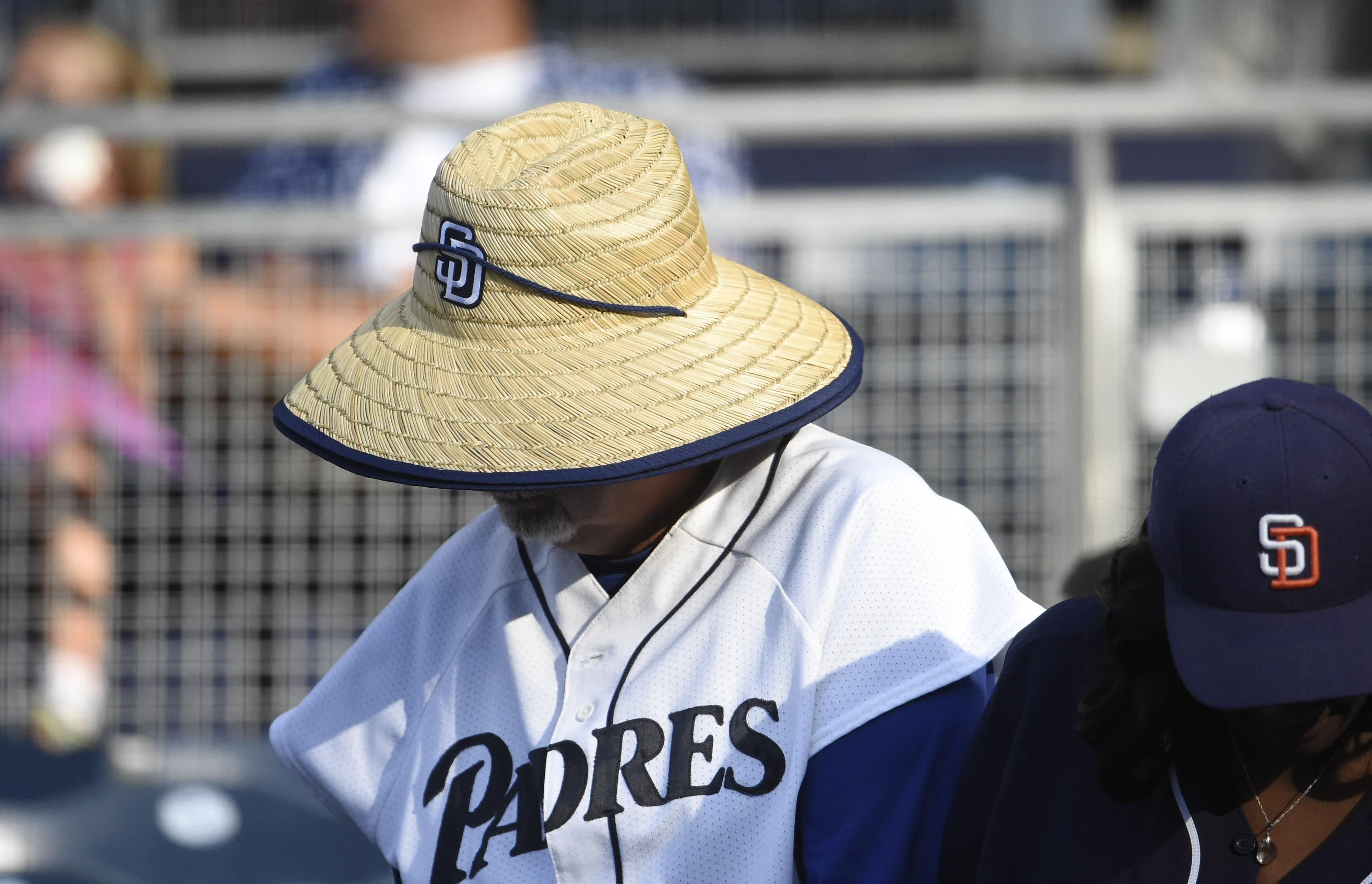 SAN DIEGO, CA - SEPTEMBER 1:  A fan wears a give away hat in the stands before a baseball game between the San Diego Padres and the Colorado Rockies at PETCO Park on September 1, 2018 in San Diego, California. A problem was found with the hats and they were recalled in the third inning.  (Photo by Denis Poroy/Getty Images)