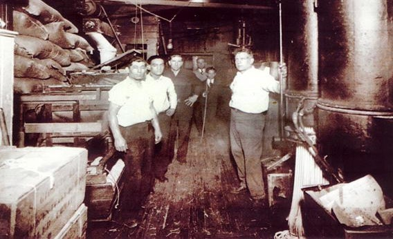 Giorgio Cataudella, right, and some of his employees at the Harlem Macaroni Co. factory around early 1930s.
