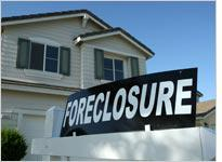 A foreclosure sign sits in front of a home