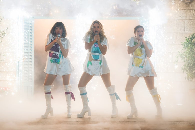 Alexa Davies, Lily James, and Jessica Keenan Wynn in Mamma Mia! Here We Go Again.