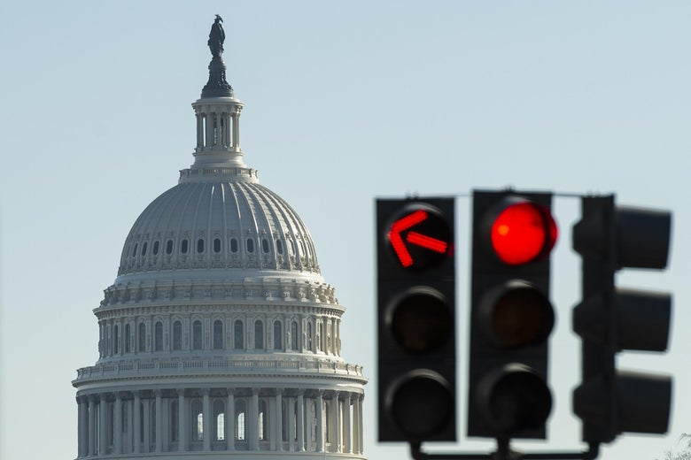 The U.S. Capitol and a red stoplight.