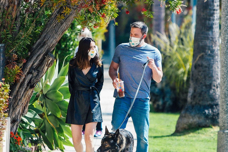 Ben Affleck walking with Ana de Armas, in face masks.