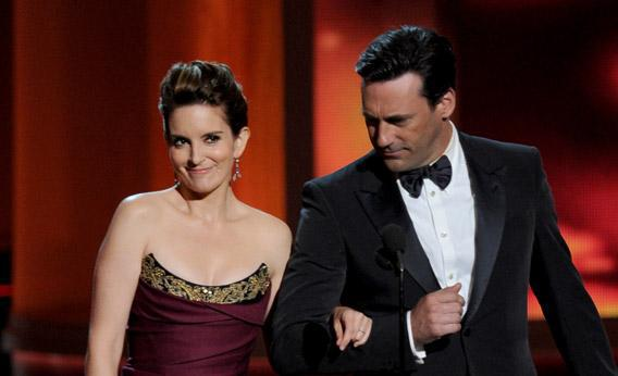 Actors Tina Fey and Jon Hamm speak onstage during the 64th Annual Emmy Awards on Sunday in Los Angeles, California.