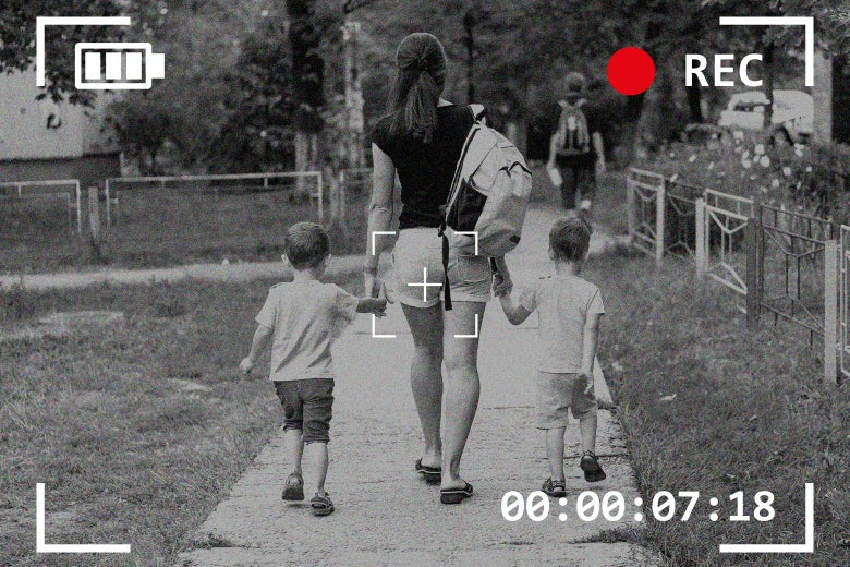 A nanny walking two boys to school through the viewfinder of a hidden camera.