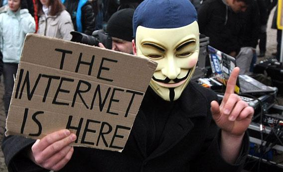 An activist in a Guy Fawkes mask
