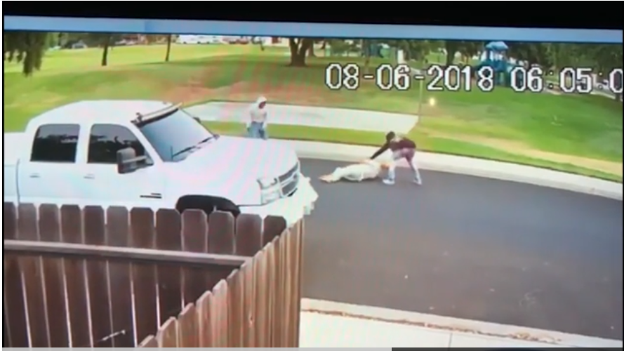 A still from a surveillance video showing two men attacking Sahib Singh Natt.