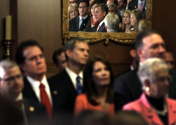 Speaker of the House Rep. John Boehner (R-OH) (C) speaks during a rally as other House Republicans look on after a vote September 20, 2013 on Capitol Hill in Washington, DC.