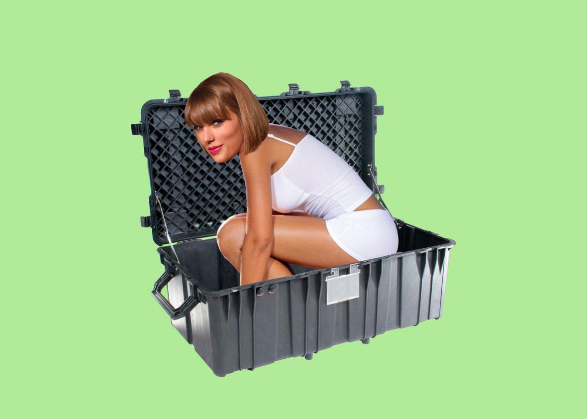 Taylor Swift Climbing Into A Box