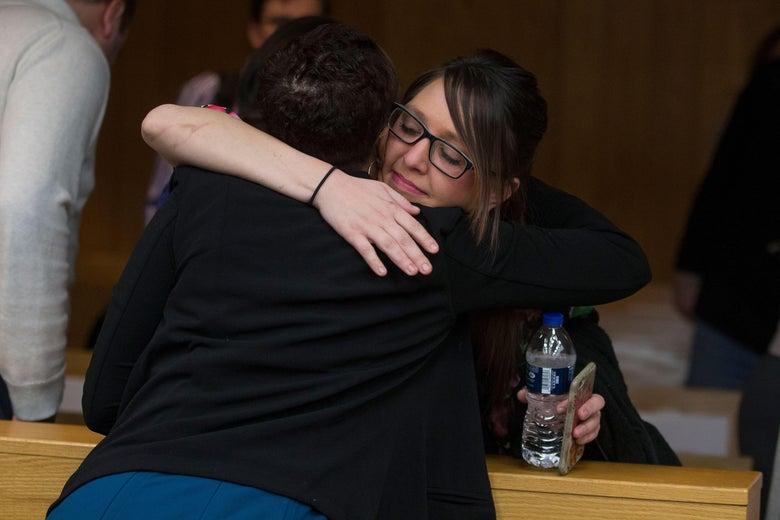 Assistant Attorney General Robyn Liddell, left, hugs Nassar victim Ashley Erickson.
