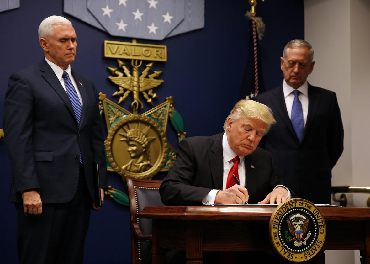 U.S. President Donald Trump signs a travel ban executive order at the Pentagon in Washington, U.S., January 27, 2017.