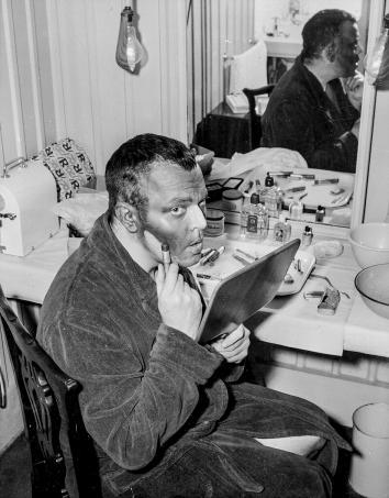 American actor Orson Welles paints his face black for the role o