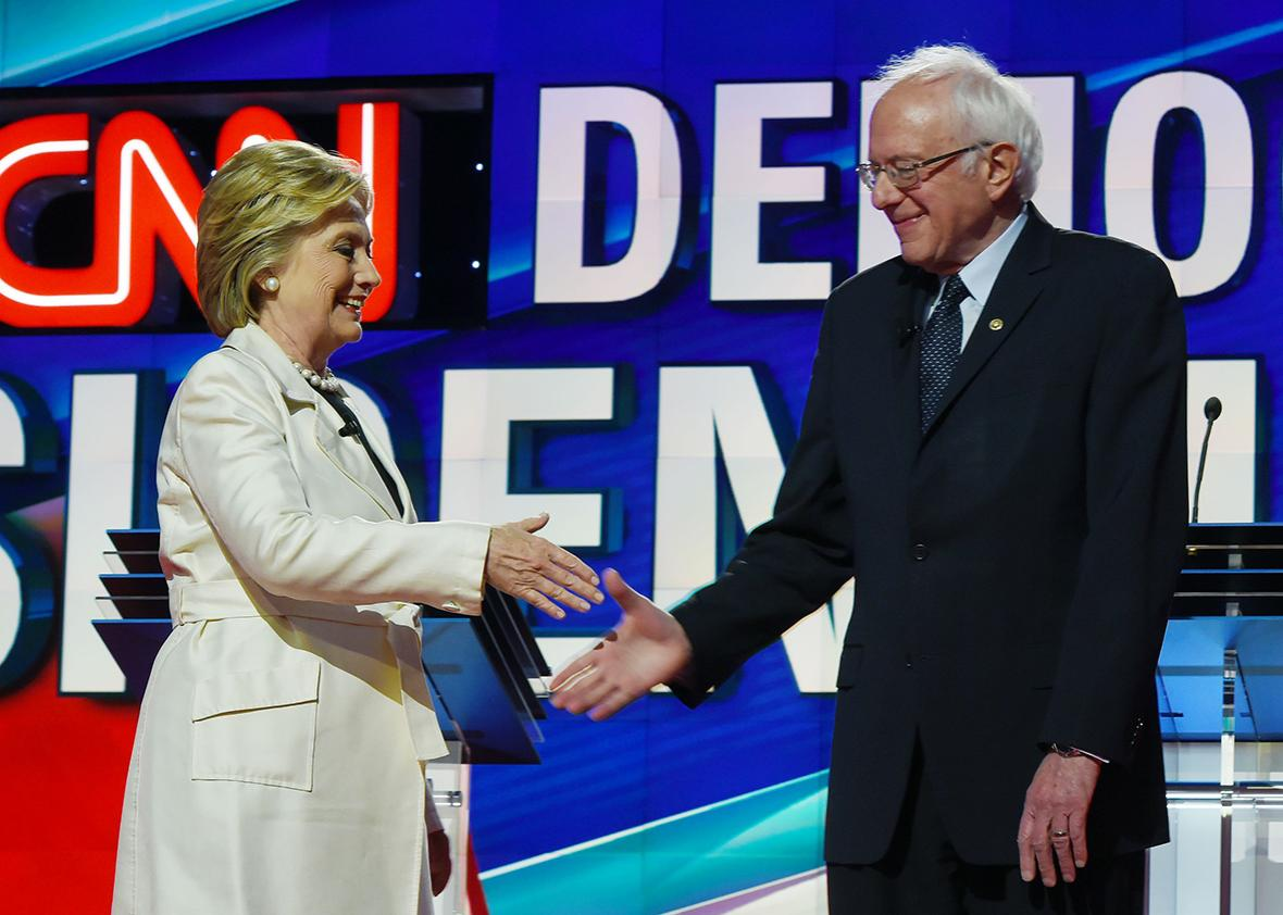 US Democratic presidential candidates Hillary Clinton and Bernie Sanders shake hands before the CNN Democratic Presidential Debate at the Brooklyn Navy Yard on April 14, 2016, in New York.