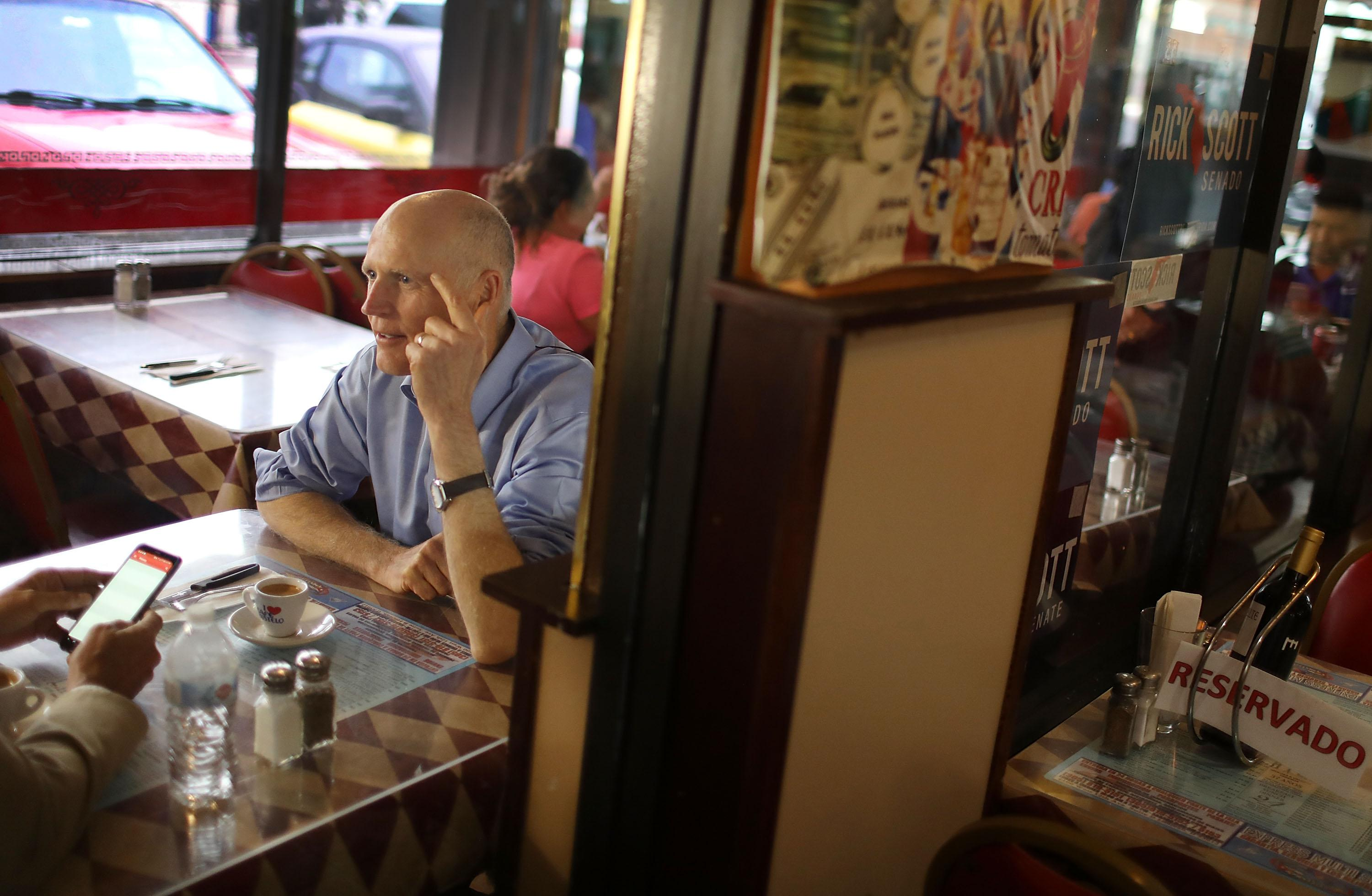 Florida Governor Rick Scott makes a campaign stop at a Cuban restaurant in June.