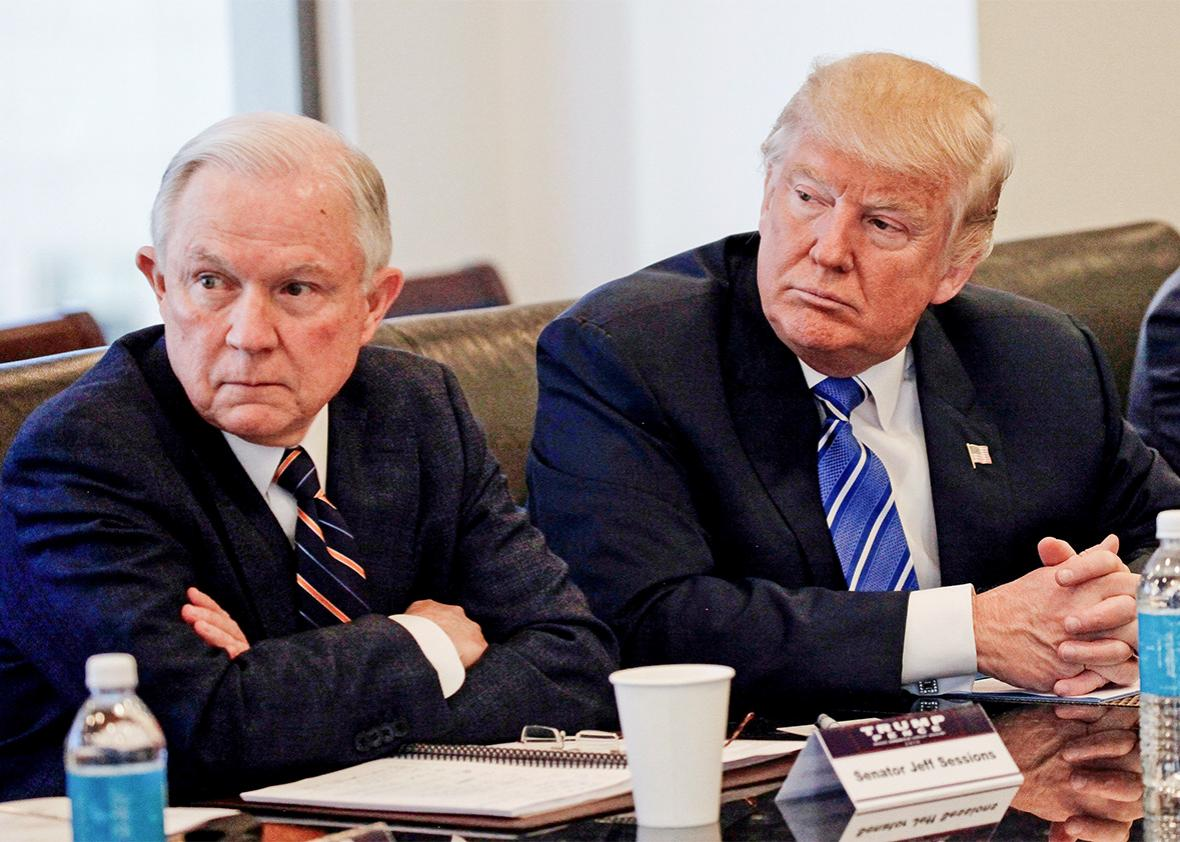 Donald Trump sits with U.S. Senator Jeff Sessions
