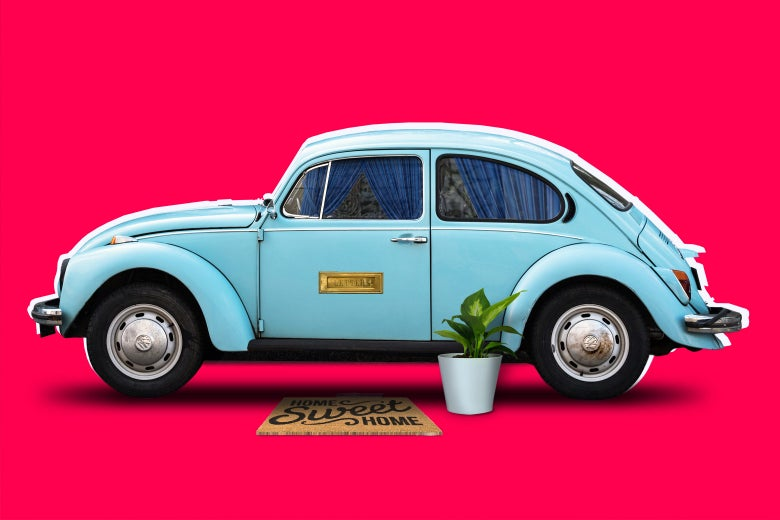 A sky-blue Volkswagen Beetle decked out like a cozy home, with curtains, a house plant, a mail slot, and a welcome mat.
