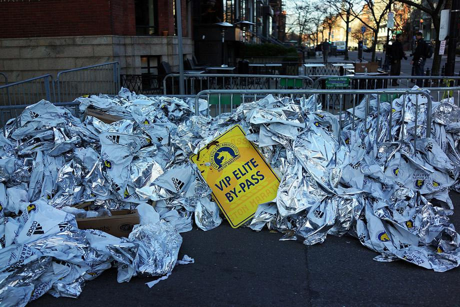 Unused thermal blankets for marathon participants are piled near the scene of a twin bombing at the Boston Marathon.