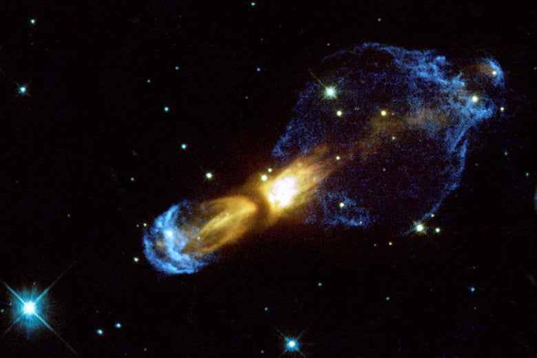 A telescope image with a large blue-yellow nebula and the center and various stars surrounding it.