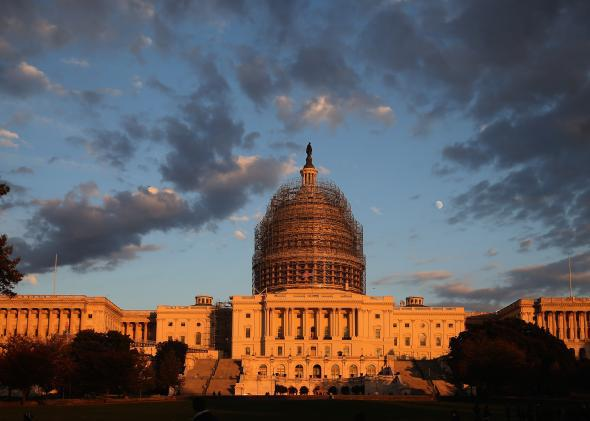The afternoon sun hits the U.S. Capitol on the eve of the nation's midterm elections, Nov. 3, 2014, in Washington, D.C.