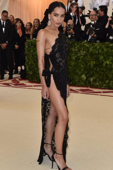 Zoe Kravitz arrives for the 2018 Met Gala on May 7, 2018, at the Metropolitan Museum of Art in New York. - The Gala raises money for the Metropolitan Museum of Arts Costume Institute. The Gala's 2018 theme is Heavenly Bodies: Fashion and the Catholic Imagination. (Photo by Hector RETAMAL / AFP)        (Photo credit should read HECTOR RETAMAL/AFP/Getty Images)