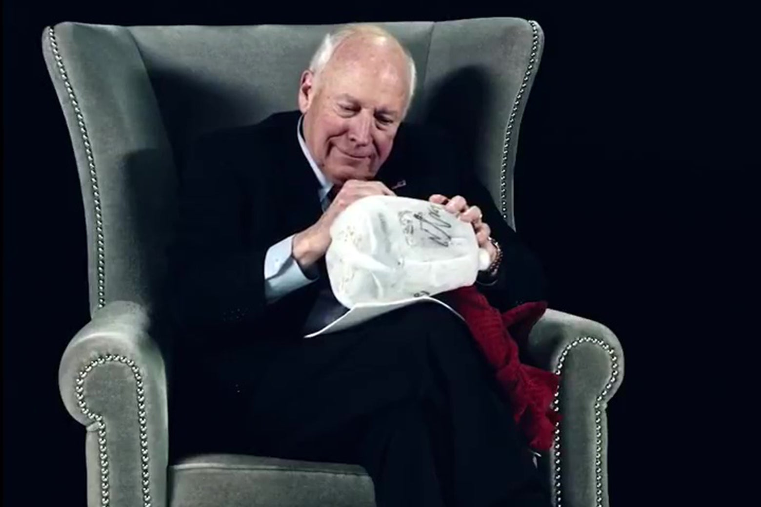 Dick Cheney signing a waterboarding kit.