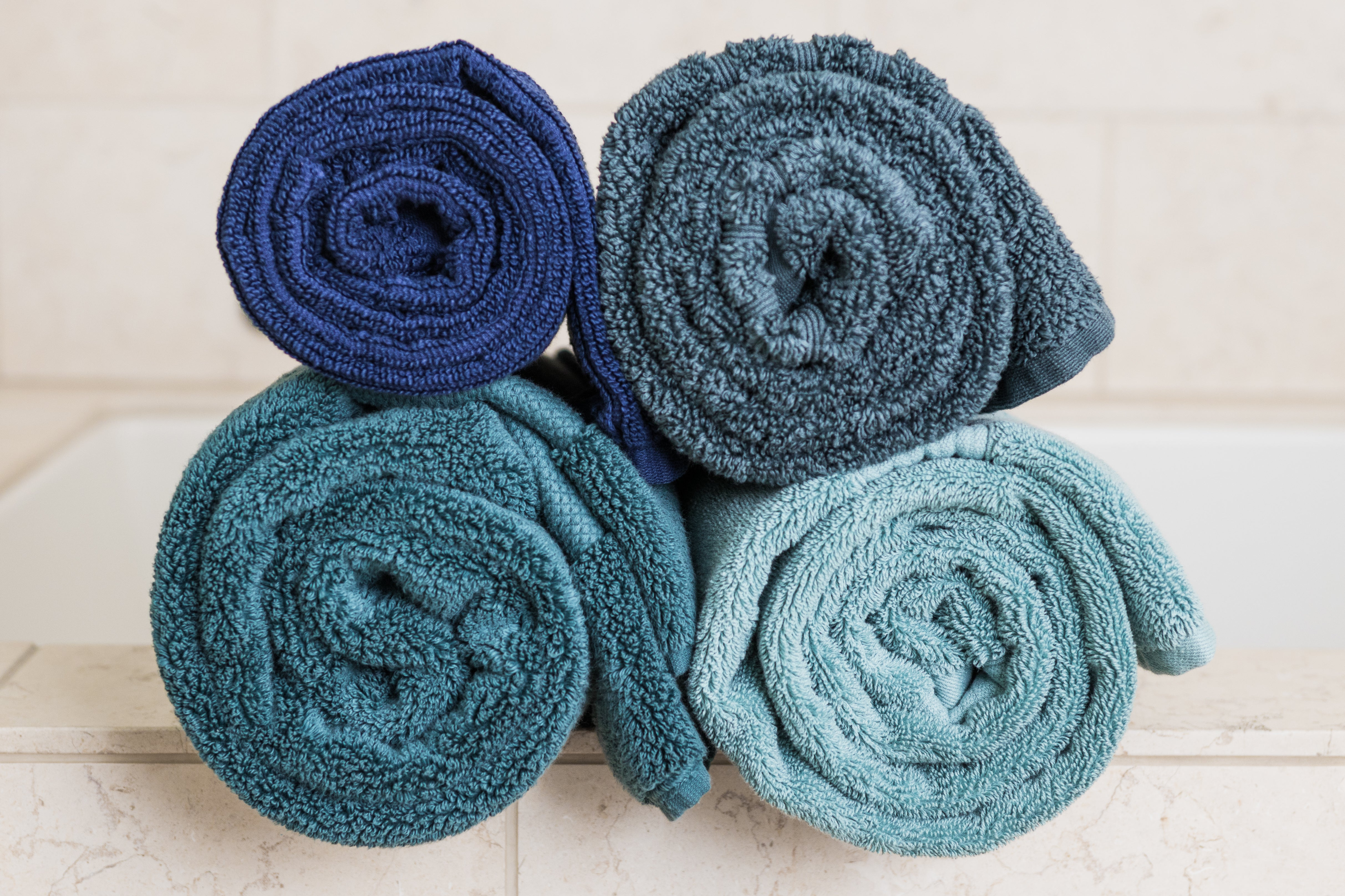 Four rolled up towels