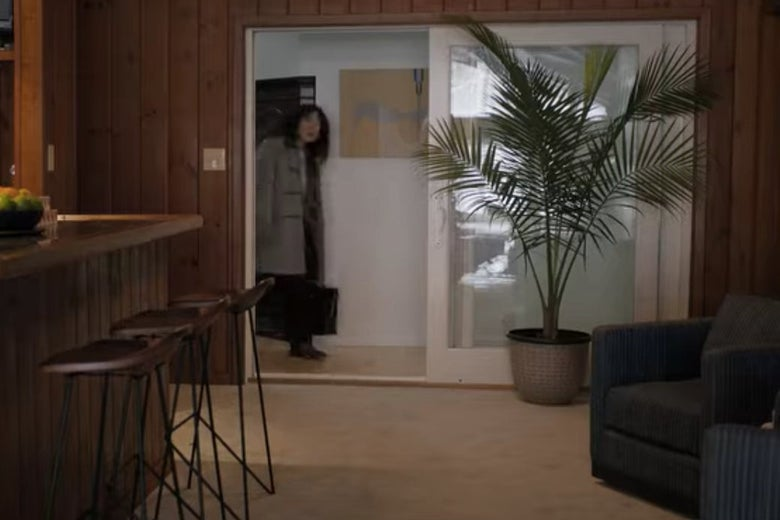 Dr. Kim walks into David Duchovny's pool area on The Chair.