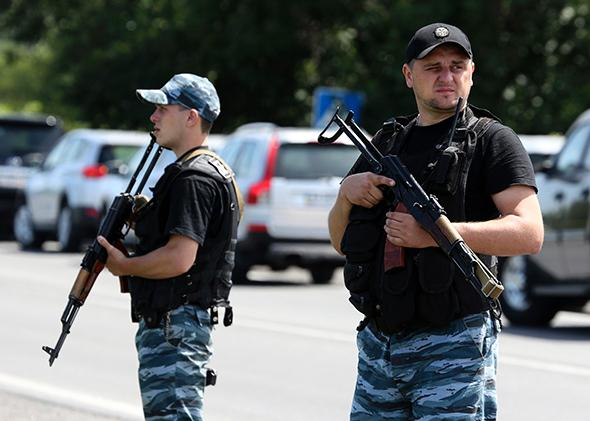 Armed pro-Russian separatists stand guard in the suburbs of Shakhtarsk in the Donetsk region of Ukraine on July 28, 2014.