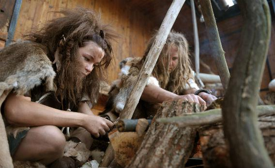 Volunteers dressed as cavemen at the Warsaw zoo.