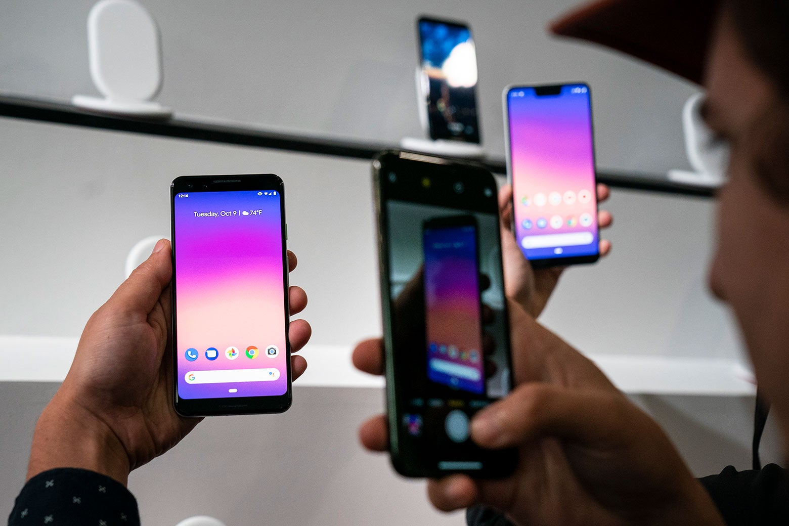 A person taking a photo of the Google Pixel 3 smartphone.