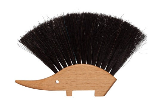 Table brush shaped like a hedgehog.